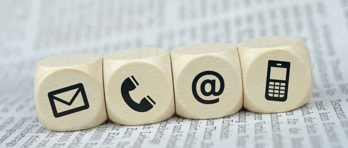 four dices with contact logos of email, telefphone, mail and mobile